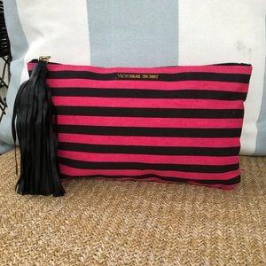 Victoria's Secret striped tasseled cosmetics bag.